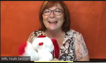 Kathy reading with puppet